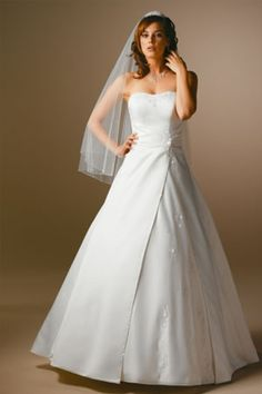 I love the veil and I love the cut of the dress and the skirt length.