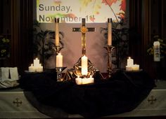 All Saints' tablescape for Sunday, Nov. 1, 2015. Sermon entitled, 'Past, Present, Future.' Candles represent beloved family, friends, church family who have passed on, & whose lives & life songs we remember. Our pastor reminded us that in our past, there's meaning for our present, & when our lives are found in Christ, we know where our future lies. Live fully & faithfully today, as Christ called us to live. For All The Saints, All Saints Day, Altar Design, Liturgical Seasons, Worship Ideas, All Souls Day, Church Decorations, Palm Sunday, Church Ideas