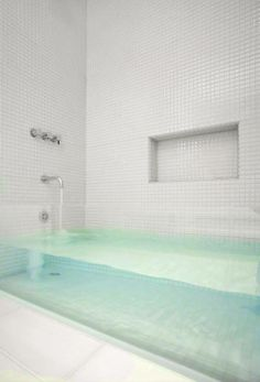 Cool bathtub different tile though on the wall...too boring with all white!