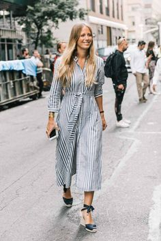 Striped midi dress and gold watches and bracelets