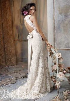 Obsessed with this open back Alencon lace gown! Jim Hjelm