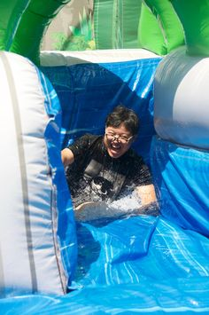 Having fun on the inflatable water slide during Water Slides, Have Fun, Camping, Games, Day, Summer, Fictional Characters, Plays, Summer Time