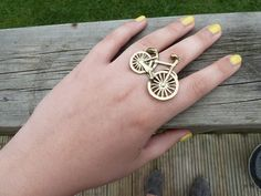 Yellow nails and bicycle ring.