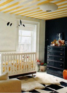 Yellow Stripes on Ceiling and Navy Blue wall... LOVE!