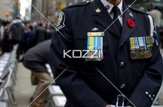 mid section of a man wearing a military uniform and badge. - Close-up mid section of a man wearing a military uniform and badge.