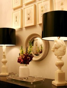 not a huge fan of the larger than life size chess piece lamps but i love the photo arrangement and tiny mirror with flowers :)