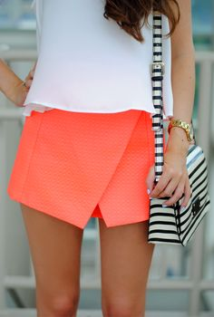 Neon skort & striped bag---love the asymmetrical skirt! Maybe in a coral. Orange and yellow don't go well with my skin tone. Love the outfit an accessory!