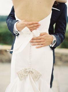 Jeweled bow back wedding dress: http://www.stylemepretty.com/virginia-weddings/somerset-virginia/2015/12/30/organic-charlottesville-wedding/ | Photography: Michael & Carina Photography - http://michaelandcarinaphotography.com/