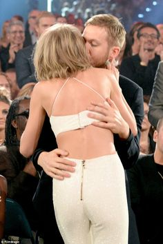 Celebration: Taylor was seen kissing her boyfriend Calvin Harris as her name was announced...