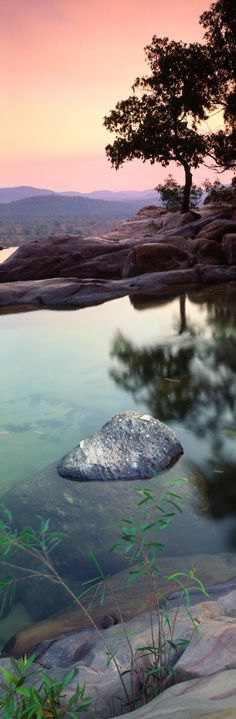 The sun rises over a stunningly clear lake in Kakadu National Park, Australia. | A.D. The Series
