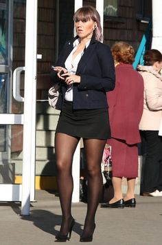 Brunette mature in miniskirt, tights / pantyhose and heels