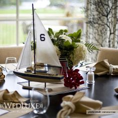 Love the idea of sailboats as part of the centerpiece with table numbers on them for a nautical wedding.