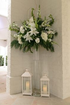 This winter wedding decor -- OMG! Romantic white lanterns and towering flower arrangements of lilies, hydrangeas, snapdragons, and bells of Ireland {Arte De Vie}