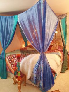 Boho Gypsy Bed Canopy . MADE TO ORDER 4 week creation time..must purchase first.. This one is all blues, aquas, turquoise One of a Kind Beauty for your Bedroom, Wedding, Garden Party , Patio, Hippie Meditation Room This is a wonderful canopy sewn with vintage silk saris..The sari panels have twine at each corner which is looped onto a screw-in ceiling hook..(hooks are included) Its very simple to set up. Sheer and opaque saris were used with a color palette of blues and teals..Each panel…