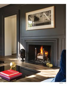 We could do something like this for the fireplace wall - not as dark though - contrast it with a piece of driftwood/wood for the mantel. Charcoal gray-eggshell sheen contrast to ivory flat sheen. Interiors - April/May 2015 Interior, Home, Home Fireplace, Fireplace Design, Living Room Decor, House Interior, Fireplace Mantels, Interior Design, Fireplace