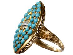 1890s Turquoise Diamond Ring -  - An exceptionally well made English Victorian turquoise and diamond ring in a marquise shaped cluster. Lovely engraving on the shoulders and beneath the gallery. In 18K gold.