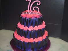 sweet 15 with purple zebra stripes and pink roses. The 16 is made out of gumpaste and sprinkles