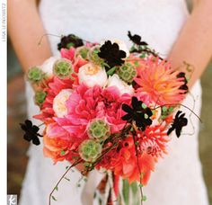 Rebecca's florist found dahlias -- the bride's favorite flower -- in a mix of soft summer hues and combined them with garden roses, sacbiosa pods, chocolate cosmos, and vines.