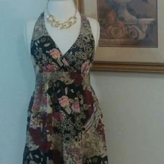 Floral open back summer dress. Beautiful open back floral dress with tie around the neck. Knee length. Never worn. Dresses Backless
