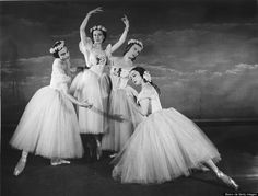 """The cast of a Festival Ballet production of Jules Perrot's ballet """"Pas De Quatre,"""" at a photo-call in London in 1950. The dancers are Nathalie Krassovska (1918-2005) as Carlotta Grisi, Alexandra Danilova (1904-1997) as Fanny Cerito, Tatiana Riabouchinska (1917-2000) as Lucille Grahn and Alicia Markova (1910-2004) as Marie Taglioni. (Photo by Baron/Hulton Archive/Getty Images)"""