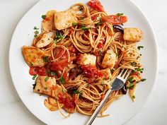 Get a healthy portion of protein and fiber by cooking pieces of tilapia in an easy garlic and tomato sauce and then tossing them with whole-grain spaghetti.