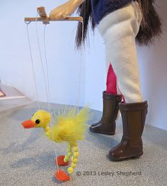 Dollhouse scale miniature walking bird marionette or puppet. Lesley Shepherd