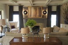 Gray Mantel & Curtains, with wood paneling painted white, neutral sectional and coffered ceiling - by Jill Tran via Dwelement blog