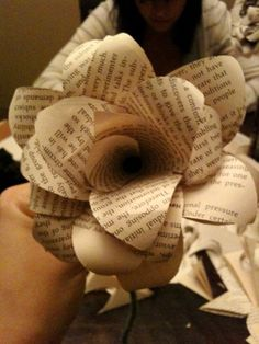 newspaper flower tutorial. the best one I have found so far.