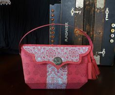 Deb uses such beautiful papers that compliments each other so well.  Her handbag is stunning, so elegant!  You can find this file in LUXURY HANDBAGS SVG KIT and make one of your own using any paper you like!  Simple and easy!