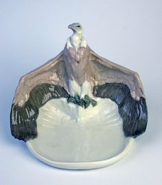 Meissen vulture perched on a dish