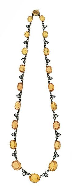 An antique topaz and diamond necklace Composed of a graduated line of oval yellow topaz with old and rose-cut diamond graduated trefoil spacers, 37.7cm long