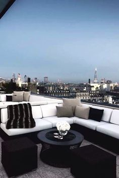 Penthouse Views.  Black & white lounge seating with a spectacular view.
