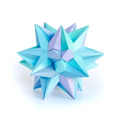 My name is Ekaterina (Kate) Lukasheva. I am a modular origami artist. Origami is the art of paper folding.