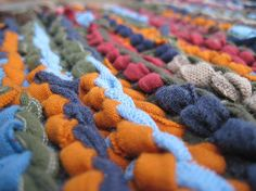 Burgundy, orange, moss green, and a variety of blue collide in our fall placemats. They are a warm accent to country, primitive, or rustic decor styles.  http://www.etsy.com/listing/84708655/rustic-fall-trivets-knitted-upcycled-t