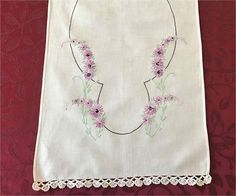 Very pretty white linen table run with purple embroidered flowers crocheted ends.   13 x 39 inches.