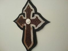 Leather and hair on hide cross