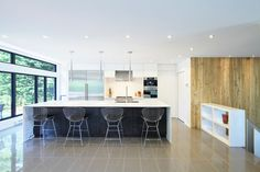 Streamlined kitchen with Corian countertop and Bertoia stools.