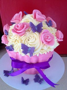 Luxury giant cupcake with hand made roses and glittery butterflies