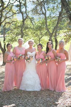 Bride with Bridesmaids in Peach Dresses | Brides.com