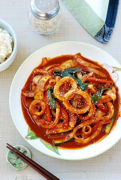 """""""Ojingeo bokkeum is a spicy stir-fried squid dish. Ojingeo is squid, and bokkeum refers to the dishes that are stir-fried. If you love squid and spicy food, this flavor packed dish is easy to make with a few staple Korean ingredients. Squid Recipes, Spicy Recipes, Seafood Recipes, Asian Recipes, Mexican Food Recipes, Healthy Recipes, Dinner Recipes, Ethnic Recipes, Healthy Food"""