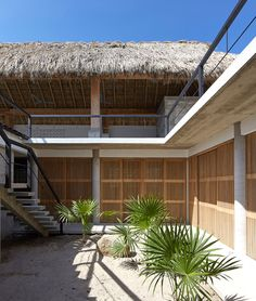 This wooden frame is covered with layers of dried palm leaves, commonly used in the region because they provide shelter while also allowing natural ventilation. Buildings with these types of roof are known locally as Palapa.