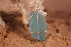 Check out this item in my Etsy shop https://www.etsy.com/listing/213931855/simple-aqua-sea-glass-pendant-p1