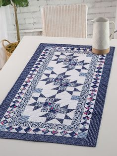 EXCLUSIVELY ANNIE'S QUILT DESIGNS: Blue Carolina Table Runner. Order here: https://www.anniescatalog.com/detail.html?prod_id=143831&cat_id=1644