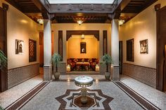 Open courtyard with a beautiful fountain and modern Moroccan tiling in a Marrakesh Riad, Morocco. Modern Moroccan, Moroccan Design, Moroccan Tiles, Moroccan Decor, Style Marocain, Persian Architecture, Spanish House, Restaurant Interior Design, Moorish