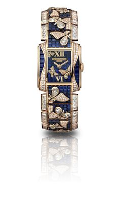 Butterflies.  Twenty~4® Haute Joaillerie.  Fully paved with baguette, drop, and brilliant-cut diamonds and baguette-cut sapphires,all set into a graceful diamond butterfly pattern on a sapphire background. Case, dial, and bracelet set with 262 baguette diamonds (~ 15.74 cts), 34 drop diamonds (~ 1.62 cts), and 1,300 diamonds (~ 2.77 cts). Total: 1,596 diamonds (~ 20.13 cts) and 613 baguette sapphires (~ 22.36 cts). Rose gold.