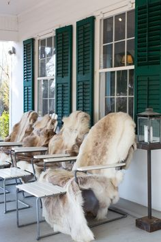 The quickest way to fall-ify your front porch? Toss some sheepskin throws onto your plastic, wood, or metal outdoor furniture.