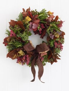 Learn how to create and arrange a fall foliage and berry wreath with these step-by-step instructions at HGTV.com.