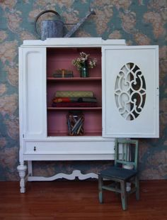 vintage cabinet done in old white chalk paint®, with the inside painted in annie sloan's 'hydrangea'...2 parts old white to one part scandinavian pink. {annie's vintage world map fabric is on the wall in the background.} | me & mrs. jones, memphis