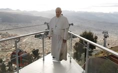 In this July 3, 2015 photo, a life-size cutout image of Pope Francis stands over La Paz, seen from the cable car platform in El Alto, placed there by the transportation workers for commuters to pose with for photos, part of the city's promotion of the pope's upcoming visit to Bolivia. The pope's trip to South America that includes Bolivia is set for July 5-12, though he will only spend four hours in Bolivia's capital due to the altitude, church officials say. (AP Photo/Juan Karita)