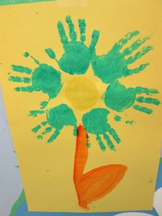 Handprint Flowers.  These colorful flowers are great for brightening up any classroom or home.  We used basic tempura paint and construction paper to create the flowers.  The students picked out their own colors and the staff helped to paint the students hands and to place them in the right position.